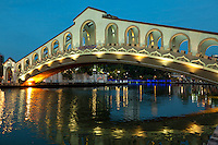 """Old Bus Station Bridge  - The Malacca River is the river that cuts across Malacca town, on its way to the Straits of Malacca. It separates the civic district clustered at the foot of St Paul's Hill, from the residential and commercial district of Heeren Street and Jonker Street. Malacca plays an important role in the development of Malacca. In the good old days the Malacca River was an important conduit for trade. In addition to being the source of fresh water it enabled access to the interior so that forest produce such as rattan, cane and resin, could to be brought down to market. As you cruise up the river, you will be able to see old shophouses along its banks. These shophouses have their warehouses, called godowns so that goods can unloaded directly from the river into them. After the Malacca Bridge near the Dutch Square, the second bridge you will pass under is the Chan Boon Cheng Bridge.  After the Chan Boon Cheng Bridge, the next bridge across the river is a foot bridge which the locals call the Ghostbridge of Malacca. How it got the name remains a mystery. Further on, another pedestrian bridge called the Old Market Bridge can be seen. The final sight before heading back on your cruise is the famous """"Kampung Morten"""" and the Kampung Morten footbridge. ."""