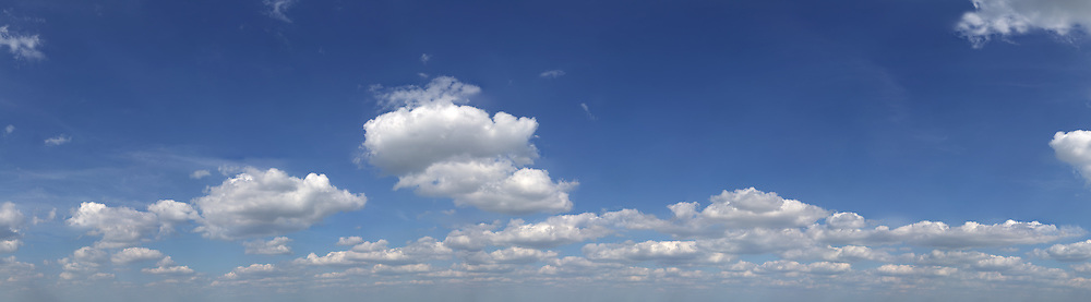 massive blue sky with small white clouds