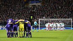 Celtic and Anderlecht team huddle during the UEFA Champions League match at Celtic Park, Glasgow.