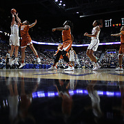UNCASVILLE, CONNECTICUT- DECEMBER 4: Natalie Butler #51 of the Connecticut Huskies shoots while defended by Kelsey Lang #40 of the Texas Longhorns during the UConn Huskies Vs Texas Longhorns, NCAA Women's Basketball game in the Jimmy V Classic on December 4th, 2016 at the Mohegan Sun Arena, Uncasville, Connecticut. (Photo by Tim Clayton/Corbis via Getty Images)