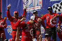 """FONTANA, CA - MARCH 26  Kyle Larson, driver of the No. 42 Target Chevrolet, wins the Monster Energy NASCAR Cup Series Auto Club 400 at Auto Club Speedway. Larson took the checkered flag at the end of the second extra lap as team owner Chip Ganassi celebrated from his perch atop the pit box. """"It's great to be Kyle Larson right now,"""" said the 24-year-old driver.. 2017 march 26.  Byline, credit, TV usage, web usage or link back must read SILVEXPHOTO.COM. Failure to byline correctly will incur double the agreed fee. Tel: +1 714 504 6870."""