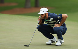 April 7, 2018 - Augusta, GA, USA - Dustin Johnson lines up a putt on the 7th hole during the third round of the Masters Tournament on Saturday, April 7, 2018, at Augusta National Golf Club in Augusta, Ga. (Credit Image: © Jason Getz/TNS via ZUMA Wire)