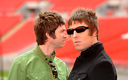 """File photo dated 16-10-2008 of brothers Noel (left) and Liam Gallagher, as Noel has hit out at brother Liam over the former Oasis frontman's criticism of his Manchester Arena bombing benefit concert performance, saying the singer needs to """"see a psychiatrist""""."""