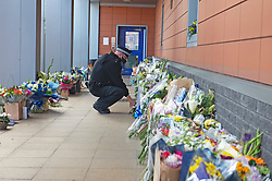 ©Licensed to London News Pictures 26/09/2020  <br /> Croydon, UK. A police officer laying flowers for Sgt Matt Ratana at Croydon Custody Centre. A murder investigation has been launched by police after the death of  custody police sergeant Matt Ratana at the Croydon Custody Centre in South London yesterday.Photo credit:Grant Falvey/LNP