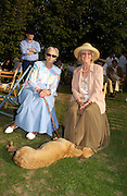 The Duchess of Richmond and Mrs. Roger Collings, The Duke of Richmond and Gordon's X1 V The Earl of March and Kinrara's X1. Cricket match before the Goodwood Revival meeting, 2 September 2004. SUPPLIED FOR ONE-TIME USE ONLY-DO NOT ARCHIVE. © Copyright Photograph by Dafydd Jones 66 Stockwell Park Rd. London SW9 0DA Tel 020 7733 0108 www.dafjones.com