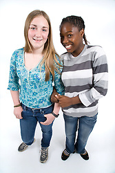 Two teenaged friends smiling,