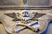 Skull and crossbones moulding, St. Audeon's Church, Dublin. Nothing to do with pirates - the symbol, and the hourglass above it refer to death, decay, and the passing of time. The examples in St. Audoen's are part of the larger Sparke and Duff wall monument, dating to the 17th century.......One of the oldest existing churches in Dublin, St. Audoens is a Norman church to St Ouen, built in 1190 to replace an earlier church to St Colmcille. The three bells in the belltower are reported to date to 1423. The mysterious Lucky Stone, an early Christian grave marker, is in the porch, where it has been since 1309. The main porch also houses the Portleister Tomb, featuring two carved effigys of the church benefactor and his wife. ..