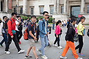 Chinese tourists visiting in a large group in London, United Kingdom. Over the last decade there has been a marked increase in tourism from mainland China.