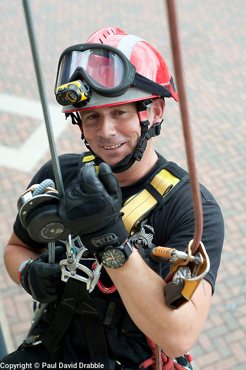 Fire Fighter Darren Monette of the South Yorkshire Fire Service Technical Rescue Unit demonstrates Abseiling Techniques at Aston Park fire station open day on Saturday.113933-04.13 August 2011  Image © Paul David Drabble