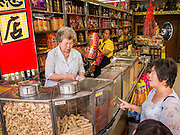 05 OCTOBER 2012 - BANGKOK, THAILAND:  A woman sells traditional Chinese medicines from a dispensary on Yaowarat Road in the Chinatown section of Bangkok, Thailand.     PHOTO BY JACK KURTZ