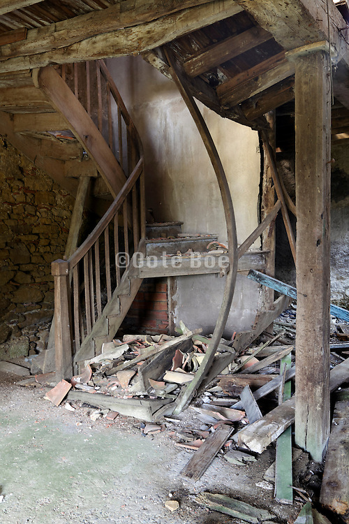stairs in decaying old farm house