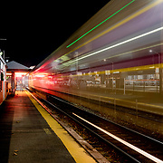 Commuter train leaves station at Wakefield, MA
