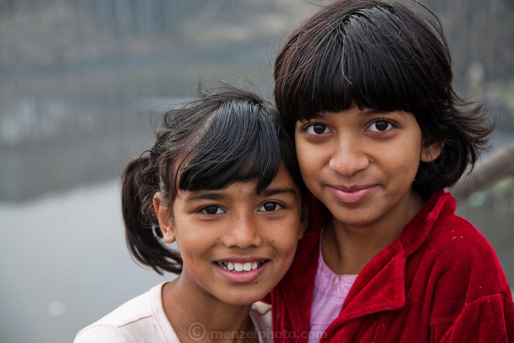 Young girls in the Chairman District slum of Dhaka, Bangladesh.