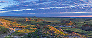 Panoramic of colorful badlands at daybreak near Ft Peck Reservoir near Jordan, Montana, USA