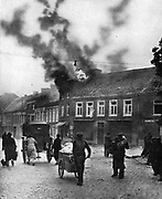 A German raid on a Belgian town: residents leaving with everything they can carry with them.