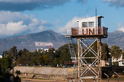 A guard tower with the turkish and the turkish cypriot flags in the UN buffer zone in Nicosia, Cyprus.<br /> Nicosia was divided into the southern Greek Cypriot and the northern Turkish Cypriot parts in 1963, following the intercommunal violence that broke out in the city. Today, the northern part of the city is the capital of Northern Cyprus, a de facto state that is considered to be occupied Cypriot territory by the international community. ©Simone Padovani / Awakening