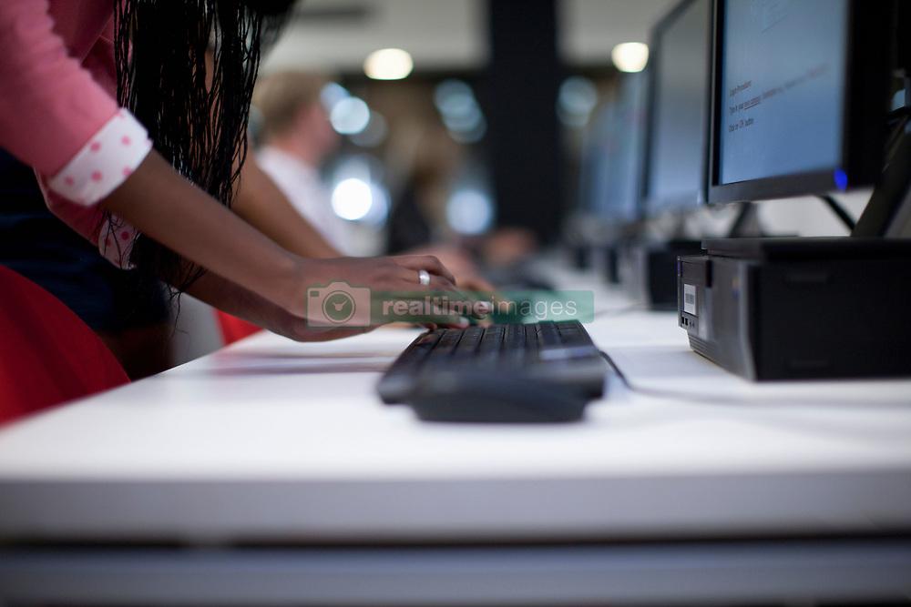 Female student using computer  keyboard in class (Credit Image: © Image Source/Albert Van Rosendaa/Image Source/ZUMAPRESS.com)