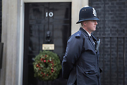 © licensed to London News Pictures. London, UK 17/12/2012. A police officer guarding Number 10 in Downing Street on 17/12/12. Photo credit: Tolga Akmen/LNP