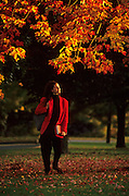 Image of a student at Amherst College in the fall, Amherst, Massachusetts, American Northeast, model released by Randy Wells