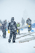 Group of people working with wood in heavy snow, Nozawaonsen, Japan