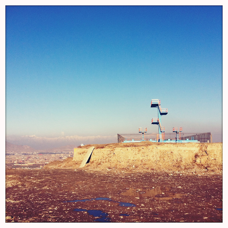 A Soviet-built swimming pool on top of a Kabul hill. The platform diving board was used by the Taliban to execute prisoners.