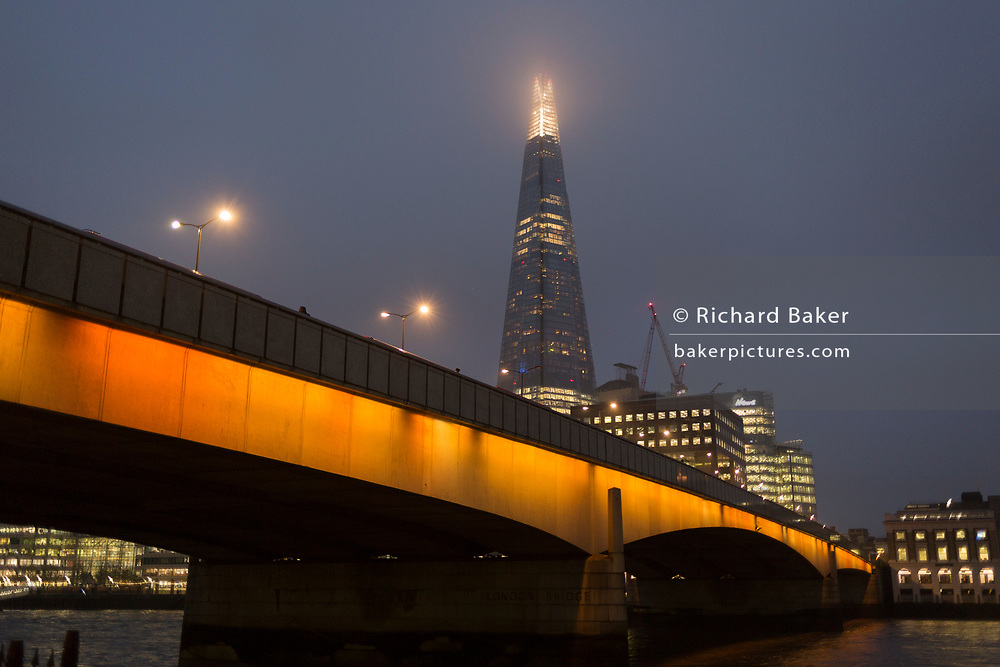 The Shard skyscraper and London Bridge on a winter's afternoon, on 23rd November 2018, in London, England.