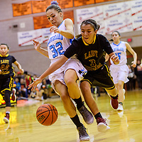 Tohatchi Cougar Krystal Benally (3) grabs a pass away from Cleveland Storm Kaylee Caldwell (32) Thursday at Gallup High School.