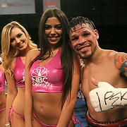 """Orlando """"El Fenomeno""""  Cruz celebrates with the Capristan ring girls after defeating Gabino """"Flash"""" Cota during their Boxeo Telemundo WBO/NABO Super Featherweight bout on Friday, October 9, 2015 at the Kissimmee Civic Center in Kissimmee, Florida. Cruz, who is from Puerto Rico, is the first ever openly gay boxer in the history of the sport and won the bout by unanimous decision.  (Alex Menendez via AP)"""