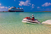 Jet ski with Disney Dream cruise ship docked at Castaway Cay (Disney's private island) in background, The Bahamas