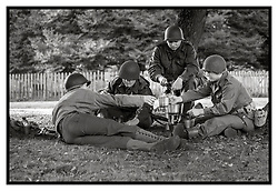 Rufford Abbey 1940's Weekend<br /> Reenactor portraying Membrs of the US army prepare field rations under a small coppice of trees<br /> <br />  30 September 2017 <br />   Copyright Paul David Drabble<br />   www.pauldaviddrabble.co.uk