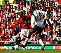 Photo. Javier Garcia<br />05/04/2003 Man Utd v Liverpool, FA Barclaycard Premiership, Old Trafford<br />Ole Gunnar Solskjær completes the 4-0 rout, firing past Djimi Traore