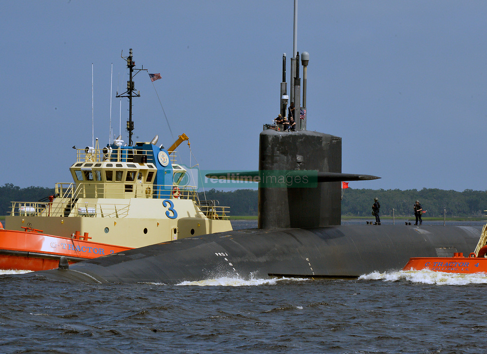 KINGS BAY, Ga. (Aug. 24, 2018) The Ohio-class ballistic missile submarine USS West Virginia (SSBN 736) returns to its homeport at Naval Submarine Base Kings Bay, Ga., following a strategic deterrent patrol. The boat is one of four ballistic missile submarines stationed at the base and is capable of carrying up to 20 submarine-launched ballistic missiles with multiple warheads. (U.S. Navy photo by Lt. Katherine Diener/Released) 180824-N-HO509-0011