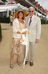 Football correspondent JIMMY HILL and his wife BRYONY at the 3rd day of the Glorious Goodrwood Racing festival 2006 - Ladies Day, at Goodwood Race course, West Sussex on 3rd August 2006.<br /><br />NON EXCLUSIVE - WORLD RIGHTS