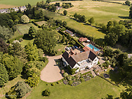 Aerial view of large country house and gardens in Boxted, Essex, UK