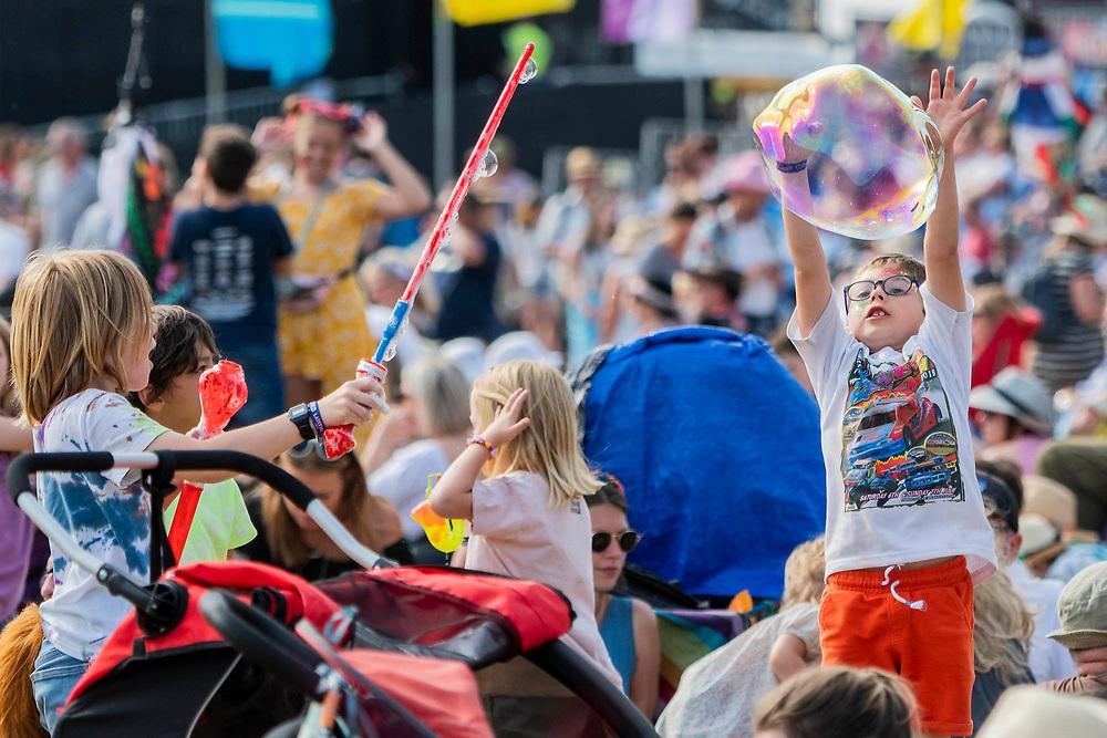 Henham Park, Suffolk, 21 July 2019. Children enjoy bubbles in the Obelisk Arena. The 2019 Latitude Festival.