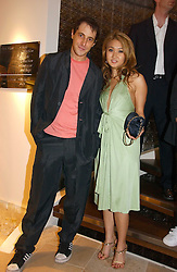 BRUCE WILPON and his wife YUKI OSHIMA-WILPON , he is the son of Fred Wilpon, the New York multimillionaire real-estate developer who the New York Mets baseball team at the opening of the new Diesel shop at 130 New Bond Street, London W1 on 18th May 2006.<br /><br />NON EXCLUSIVE - WORLD RIGHTS