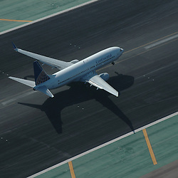 Aerial view of Continental Airplane taking off at airport in california in 2007