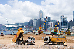 Major reclamation works in progress in Victoria Harbour for future transport and office developments in Central District in Hong Kong July 2008