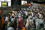 The crowded Ujjain train station during Kumbh Mela festival, Ujjain, Madhya Pradesh, India. The Kumbh Mela festival is a sacred Hindu pilgrimage held 4 times every 12 years, cycling between the cities of Allahabad, Nasik, Ujjain and Hardiwar.  Participants of the Mela gather to cleanse themselves spiritually by bathing in the waters of India's sacred rivers.