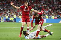KIEV, UKRAINE - MAY 26: Jordan Henderson and Andy Robertson of Liverpool compete with Isco of Real Madrid during the UEFA Champions League final between Real Madrid and Liverpool at NSC Olimpiyskiy Stadium on May 26, 2018 in Kiev, Ukraine. (MB Media)
