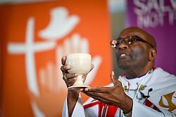 """10 May 2017, Windhoek, Namibia: Bishop Ernst Gamxamub from the Evangelical Lutheran Church in the Republic of Namibia distributing Holy Communion at the opening worship of the Lutheran World Federation's Twelfth Assembly. The Twelfth Assembly of the Lutheran World Federation, gathers in Windhoek, Namibia, on 10-16 May 2017, under the theme """"Liberated by God's Grace"""", bringing together some 800 delegates and participants from 145 member churches in 98 countries."""