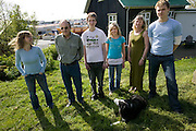 Thoroddson family at home in Hafnarfjordur, near Reykjavik, Iceland in May of 2004. A revisit, after the family was profiled in Material World in 1993. Family is in same order as the family portrait in Material World taken outside their home in December 1993. MODEL RELEASED.