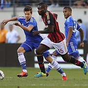 Mario Balotelli, AC Milan, challenged by Marco van Ginkel, Chelsea, (left), during the Chelsea V AC Milan Guinness International Champions Cup tie at MetLife Stadium, East Rutherford, New Jersey, USA.  4th August 2013. Photo Tim Clayton