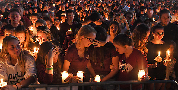 February 15, 2018 - Parkland, FL, USA - A vigil was held for the victims of the mass shooting at Marjory Stoneman Douglas High School at the Udine Amphitheatre located inside Pines Trail Park. Parkland, FL.  (Credit Image: © Sun-Sentinel via ZUMA Wire)
