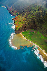 """""""Fat Man's Misery"""" rock and coral reef at Nu`alolo Kai or Nualolo Kai beach, only accessible by boat or by air, Na Pali coast, Kauai, Hawaii"""