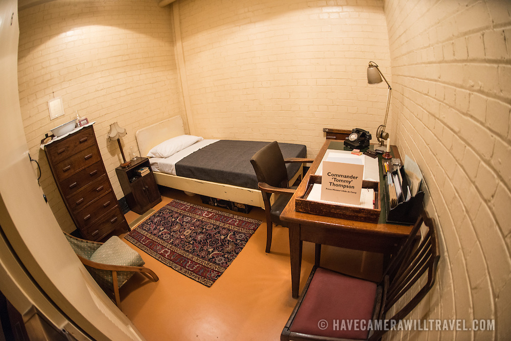 The bedroom and living quarters of Commander 'Tommy' Thompson, the Prime Minister's Aide de Camp, at the Churchill War Rooms in London. The museum, one of five branches of the Imerial War Museums, preserves the World War II underground command bunker used by British Prime Minister Winston Churchill. Its cramped quarters were constructed from a converting a storage basement in the Treasury Building in Whitehall, London. Being underground, and under an unusually sturdy building, the Cabinet War Rooms were afforded some protection from the bombs falling above during the Blitz.