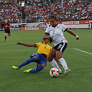 Brazil defender Rilany (2) slides for the ball against U.S. forward Sydney Leroux (2) during a women's soccer International friendly match between Brazil and the United States National Team, at the Florida Citrus Bowl  on Sunday, November 10, 2013 in Orlando, Florida. The U.S won the game by a score of 4-1.  (AP Photo/Alex Menendez)