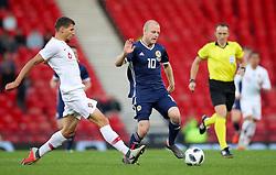 Portugal's Ruben Dias (left) and Scotland's Steven Naismith battle for the ball during the International Friendly match at Hampden Park, Glasgow.