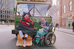 Two men; who are wheelchair users; protesting over access to public transport,
