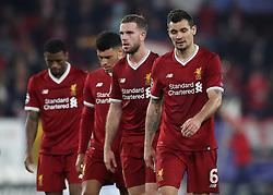 Left to right, Liverpool's Georginio Wijnaldum, Alex Oxlade-Chamberlain, Jordan Henderson and Dejan Lovren look dejected after the game